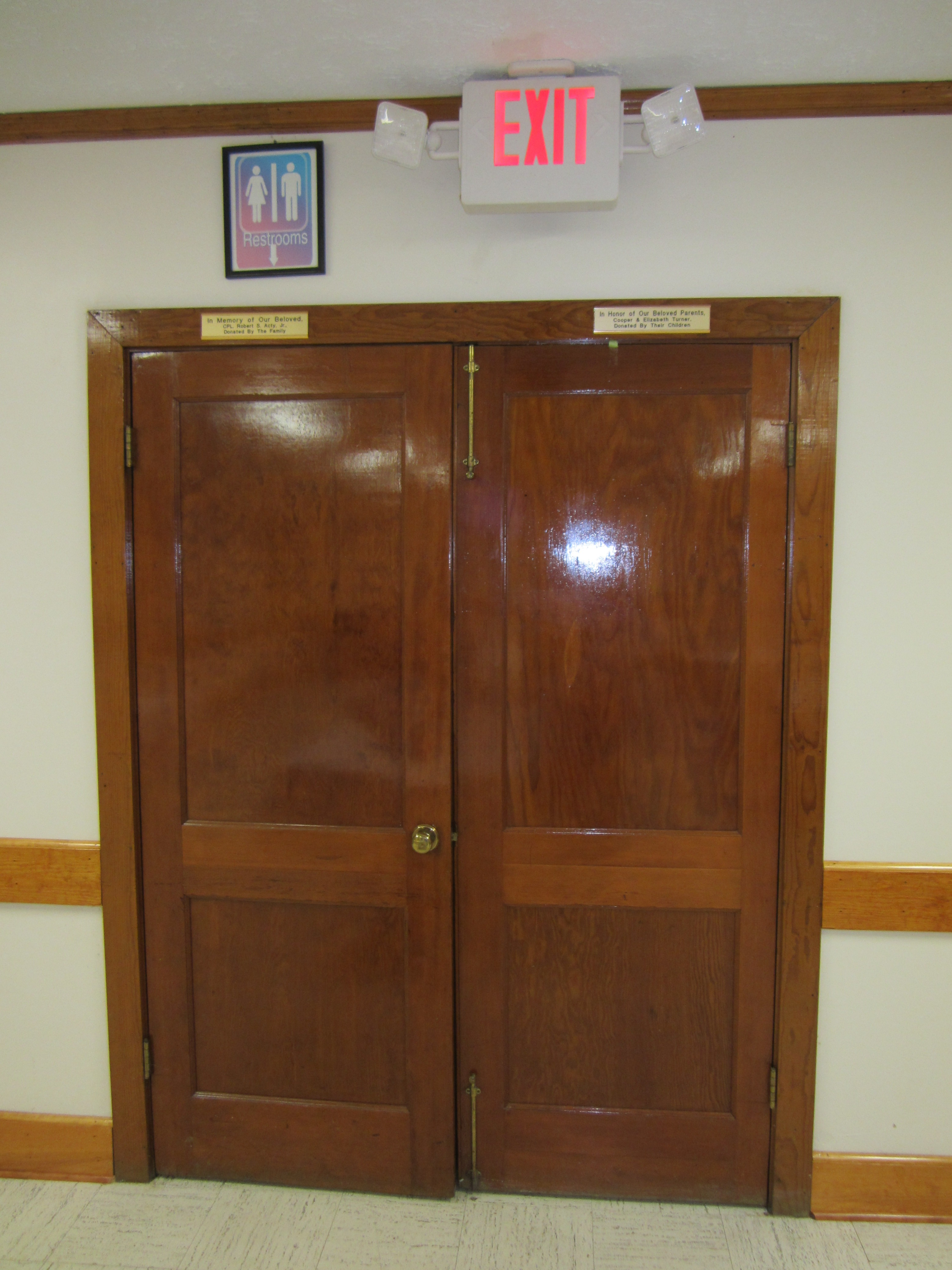 Double doors leading to hall and bathrooms